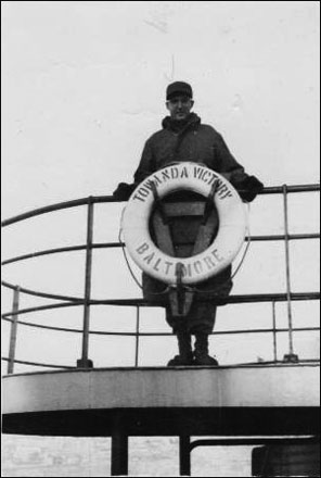 "Frank Cline standing on the Towanda Victory, caption ""exiting Chosin Reservoir"""