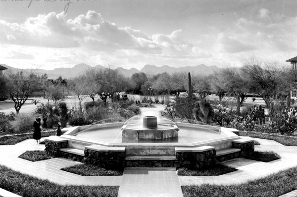 "The Memorial Fountain. In her book, A Photographic History of the University of Arizona 1885-1985, Phyllis Ball wrote: ""Situated at the west entrance of Old Main, the Memorial Fountain, honoring those UA students who lost their lives in World War I, was the gift of Alexander Berger, an uncle of Alexander Tindolph Berger, one of those to whose memory it is dedicated. Designed by Tucson architects, Lyman and Place, it cost $5,500. The Cactus Garden continued to flourish on its western side."" Compare this photo to one shot in June 2007 from the same location."