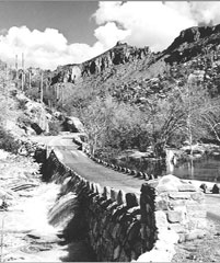Black and White photo by Abbott of bridge with water flowing under it