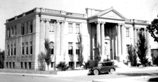 ucson City Hall at the turn of the century. The building was constructed of adobe on the bottom and wood frame on top. Note the stage times posted on the side of the building.