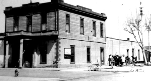 Tucson City Hall at the turn of the century. The building was constructed of adobe on the bottom and wood frame on top. Note the stage times posted on the side of the building.