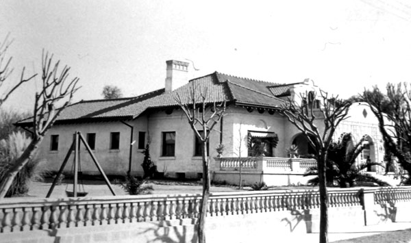 The J. Knox Corbett home on North Main Avenue. This home is an excellent example of the Mission Revival Style of architecture, a style heavily influenced by California buildings. Corbett was a prominent Tucson businessman and postmaster. Holmes and Holmes, Architects, designed the building which was completed in 1907.