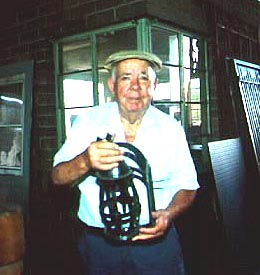 William Flores with light fixture, August 1994 (CV)