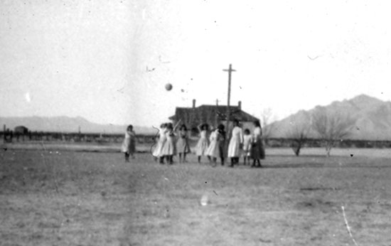 Girls at the Tucson Indian School playing ball. The building behind them is the school which started classes in 1888. For the first few years, the school was larger than the University.