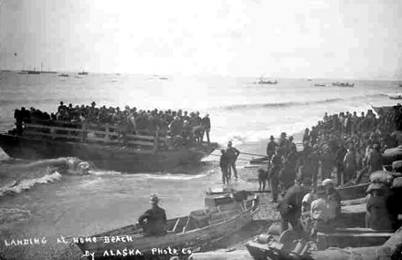 Tom Marshall acquired this photo showing Stampeders ferried from ships to Nome Beach.