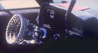 Steering wheel made of chrome chain links. A fairly plain interior with a complex chain-link steering wheel, this low rider was photographed at the Tucson Meet Yourself folklife festival in October, 1990 [image courtesy of James S. Griffith]