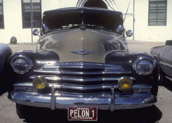 PELON #1 classic low rider, photographed near San Xavier Mission in March, 1984.  When classic cars are turned into low riders, they usually are not seriously modified inside or out.  [image courtesy of James S. Griffith]