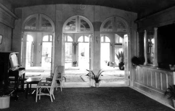 The interior of Maricopa Hall. On the desk to the right, young ladies had to sign in and out of the building and state their destination. Note the many Navajo rugs in the reception room.