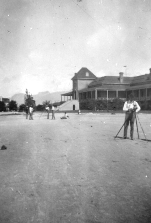 Surveyors in front of the Main Building