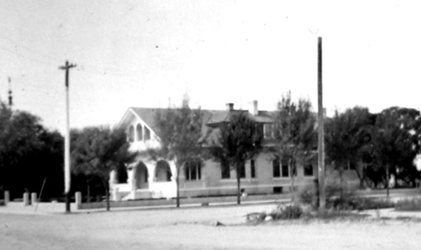 Looking west through the Main Gate at the Pi Beta Phi Sorority house. Mrs. Marshall, Mrs. von KleinSmidt and others helped establish the first national chapter of a Greek-letter society for women at the University of Arizona. For some time the building was owned by the Marshalls.