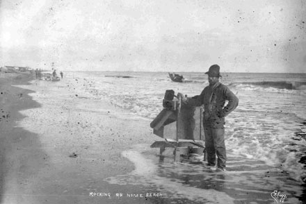 This photo shows a miner sifting sand for gold dust on Nome Beach.
