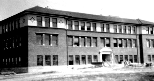 The Science Hall, built in 1909, is larger than, but similar to the former library-museum. This photo was taken during construction. Currently known as the Speech Building, it is the fourth oldest building on campus.