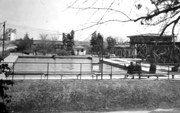 This swimming pool was constructed in 1916 and also served the University as a water reservoir. Note incomplete observatory to the rear.