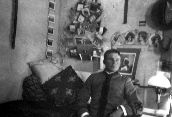 Thomas Marshall in military uniform in his dorm room in South Hall. His diary notes that as a cadet in 1901 he participated in the dedication of the State Capitol in Phoenix. In the 1903 Burro, the first University of Arizona yearbook, he is pictured as a Lieutenant.