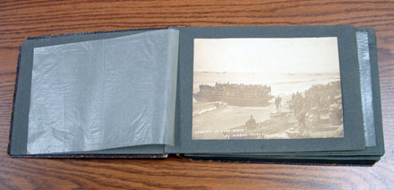 om Marshall's original photo album containing prints of t he photos he shot while aboard ship and in Nome.