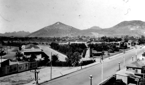 "The freight depot was located due east of the passenger facility. The EP&SW was purchased by the Southern Pacific Railroad in the early 1910s. In 1923 the Southern Pacific converted the freight depot into a railroad hospital. In later years, the facility came to be known as the Carl Hayden Hospital. Note the conical volcanic peak in the background that formerly had been known as Sentinel Peak and has been converted over to ""A"" Mountain."
